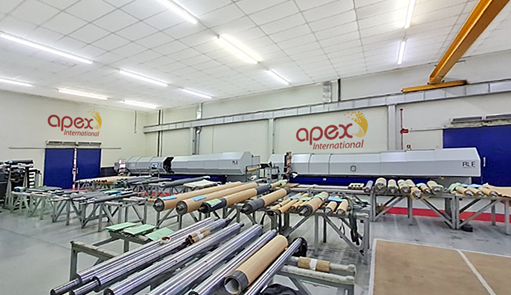 Apex Latin America´s laser room featuring brand-new laser engraving machine at right.
